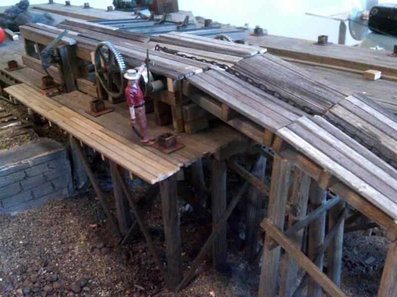 Swen has a handle on the log haul, the metal footers hold the wall columns